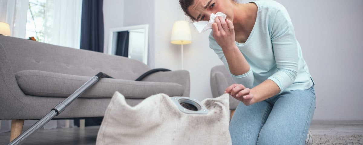 Woman Cleaning Dusty Carpet