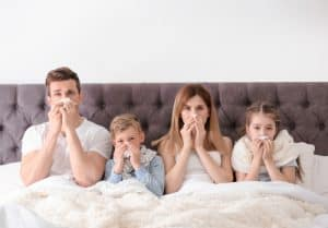 An image of a family sick with the flu